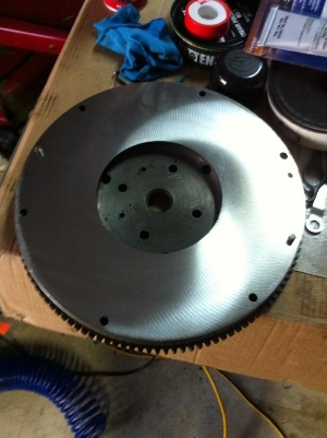 Flywheel re-surfaced, ready for installation.